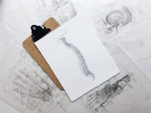 Background image showing chiropractic tests and illustrations.