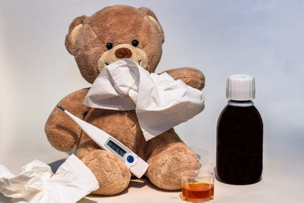 Flu Season is Here. Image of a cute, sick teddy bear to illustrate immune-boosting ideas to stay well.