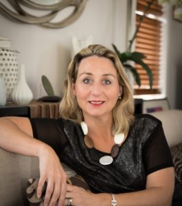 Anna Cuthbert Interior Designer Sitting on Couch