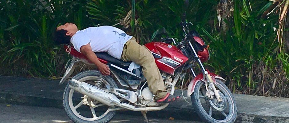 Man sleeping on motercycle