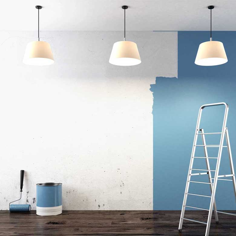 Residential and Commercial Painting - Wall being painted blue & white