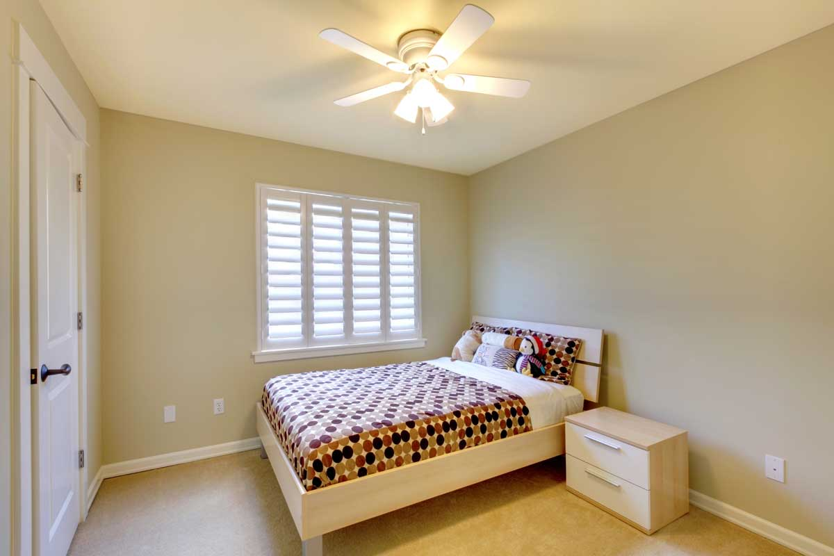 Residential home bedroom interior painted white and light green