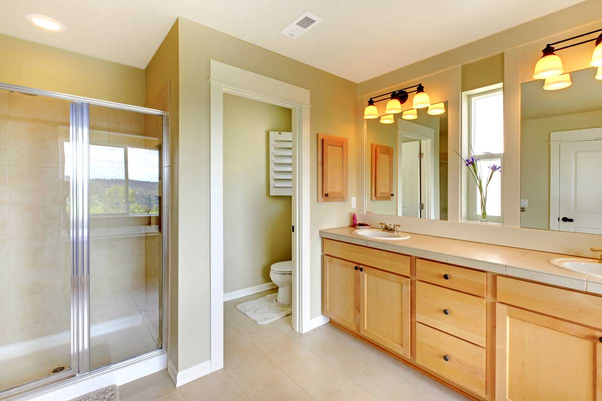 Residential home bathroom interior painted light green and white