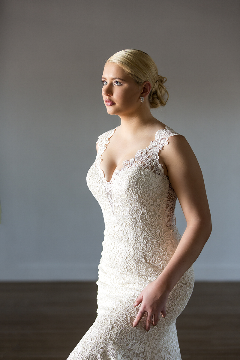 A portrait of a bride in a wedding gown indoors in Gladstone