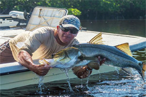 Matlacha guide Tim Jones with a trophy snook he caught
