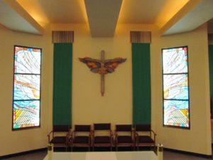 crucifix behind the altar