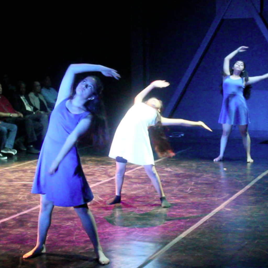 3 girls dancing on stage demonstrating self-expression