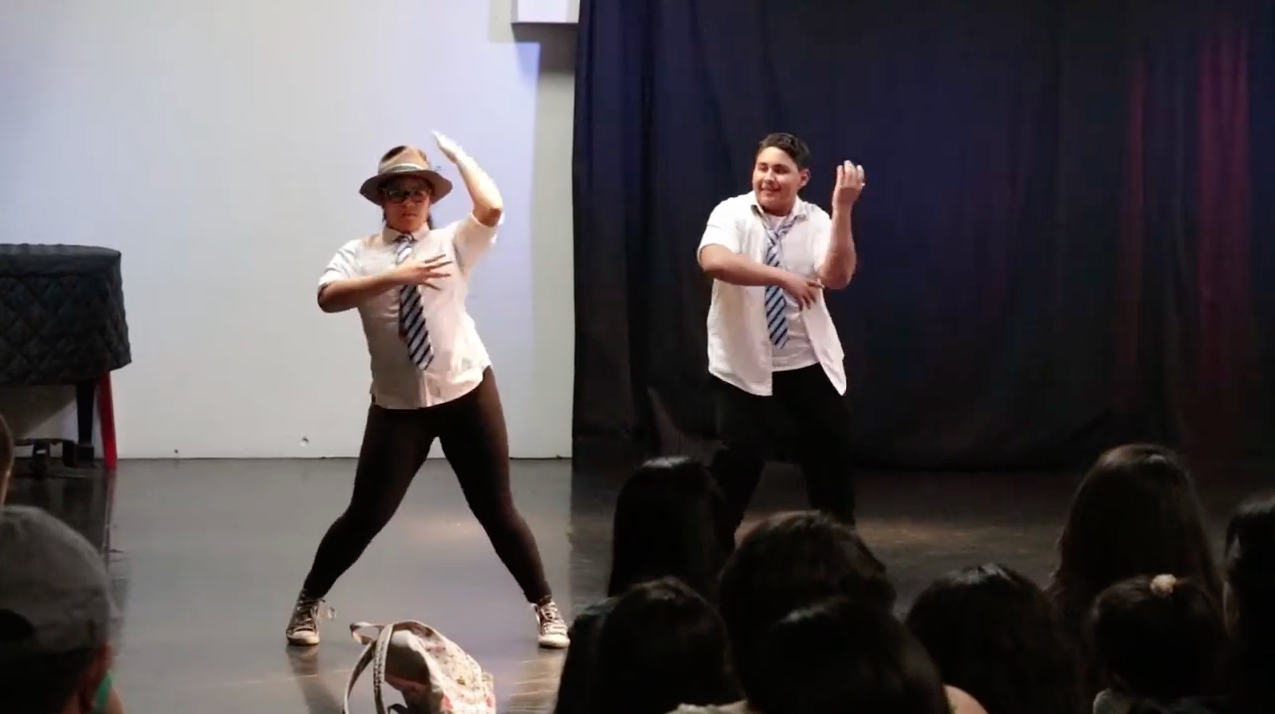 Girl and Boy Dancing on Stage