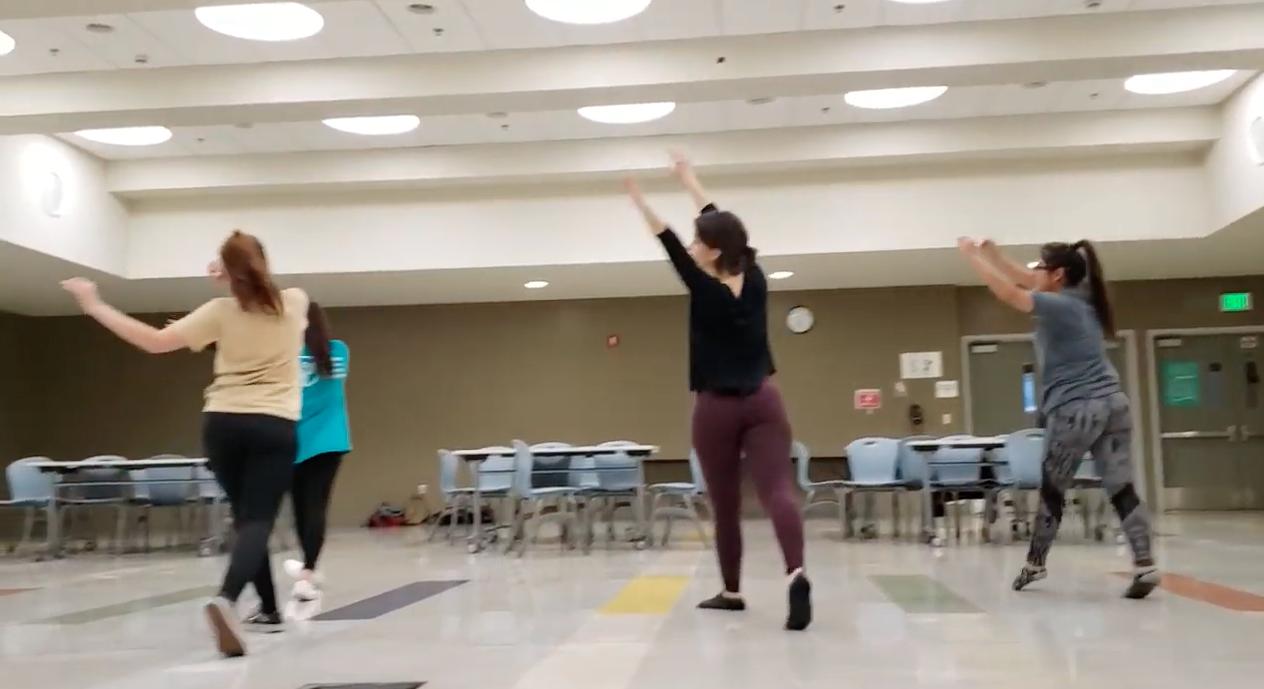 Teens taking dance class indoors