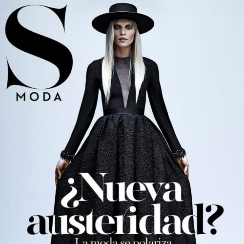 Cover of S Moda Magazine with woman in dark dress and hat