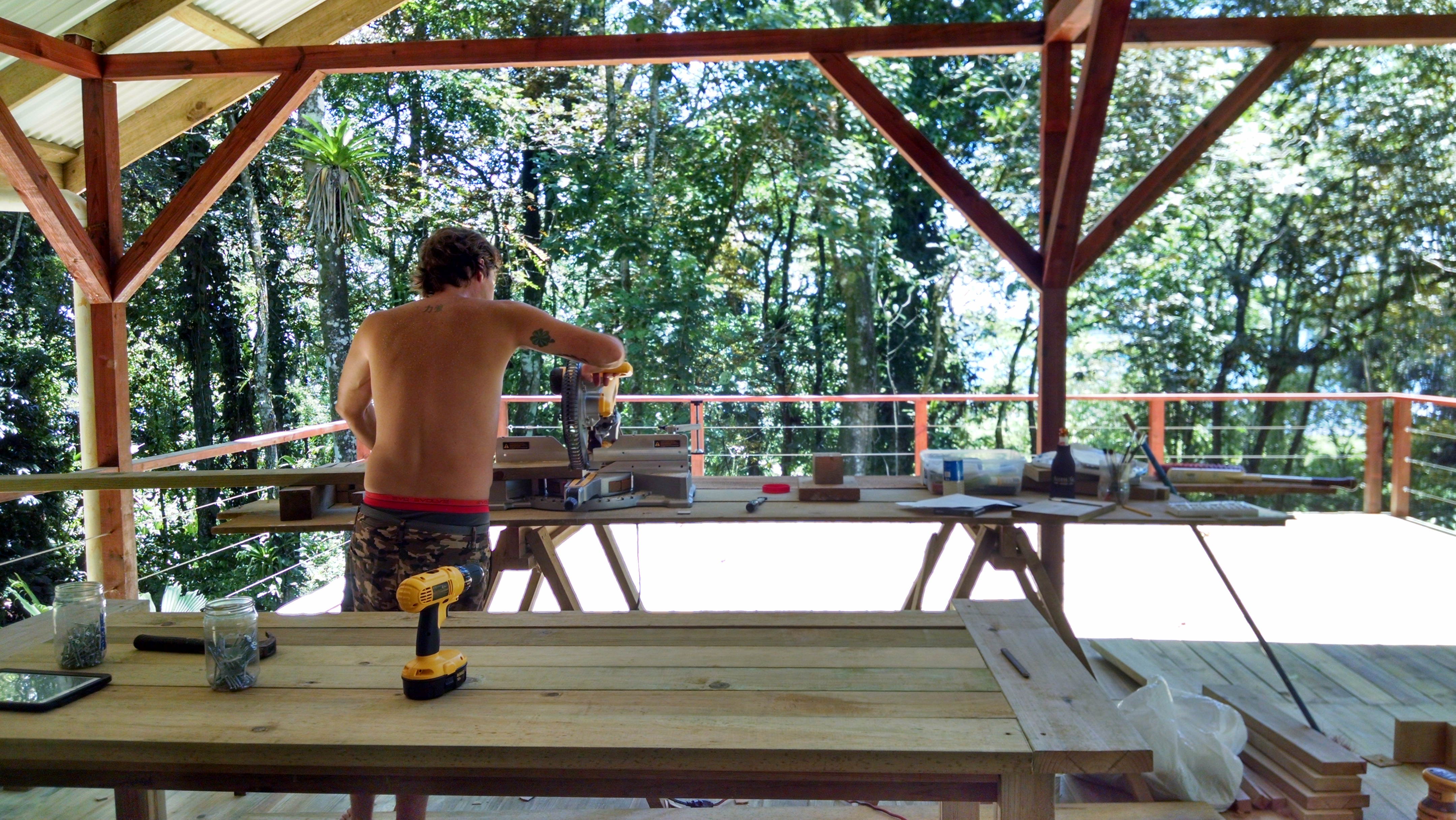 Photo of David working on table - with an amazing view while he works.