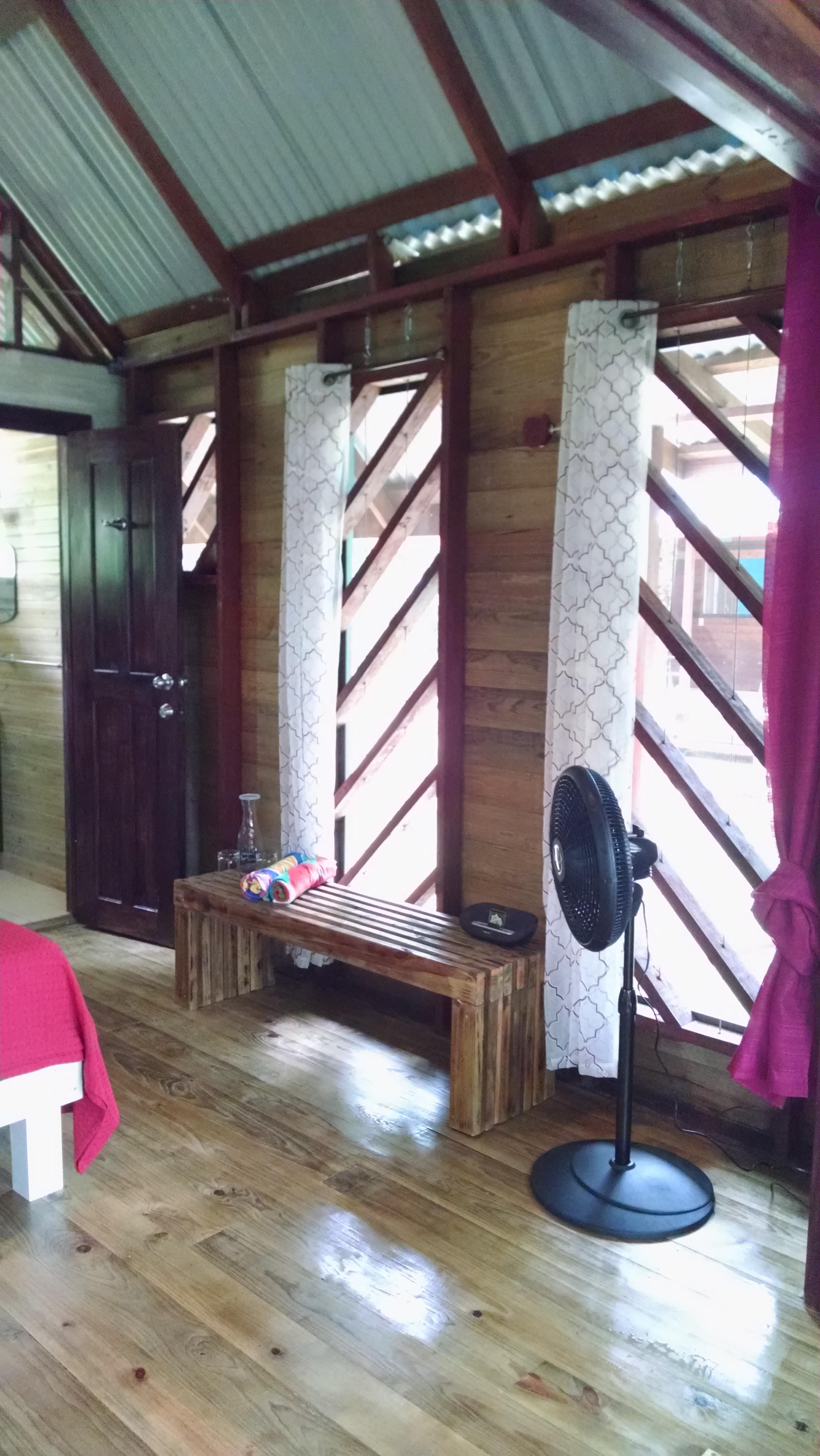 Tree Cabin - custom handmade bench, beach towels and floor fan to keep you comfy.