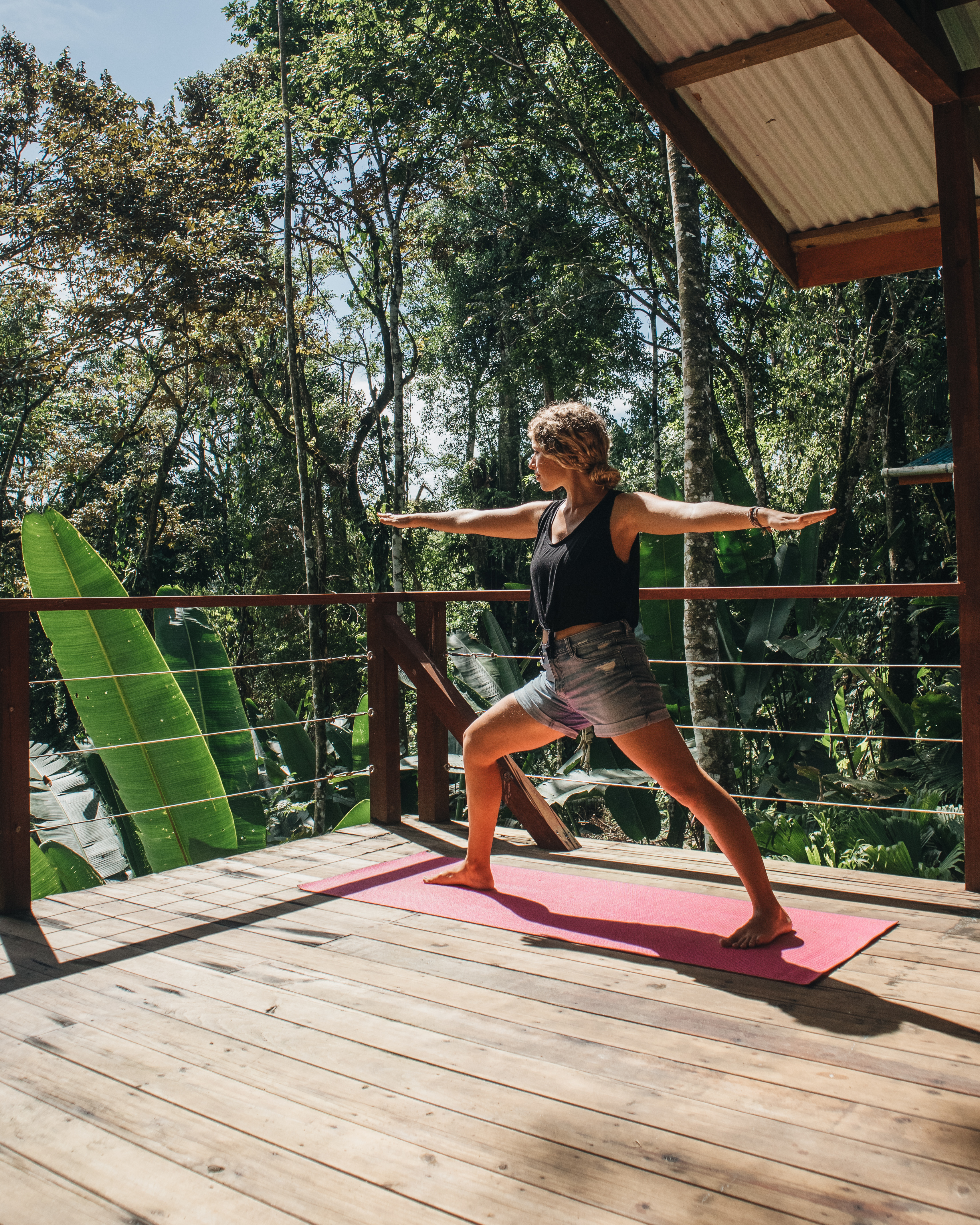 Tree Bungalow Right Deck with Guest Doing Yoga