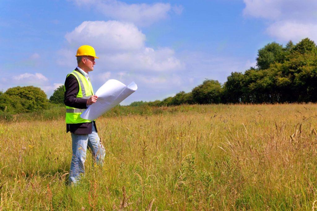 Surveyor reading site plans