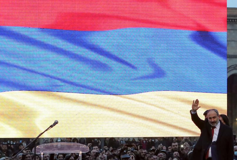 Armenian leader, in standoff with army, announces early election on June 20