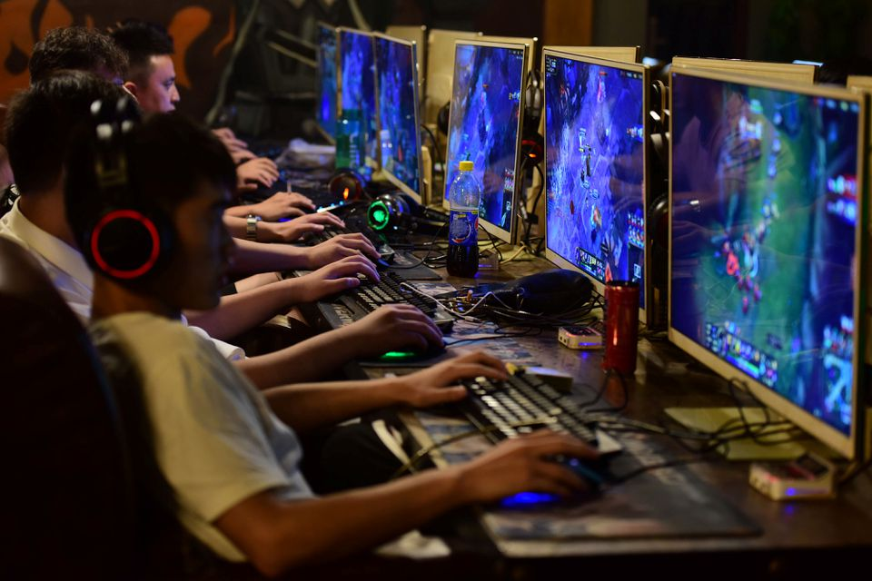 Young Chinese gamers vent at Beijing's new rules as shares in gaming companies slide