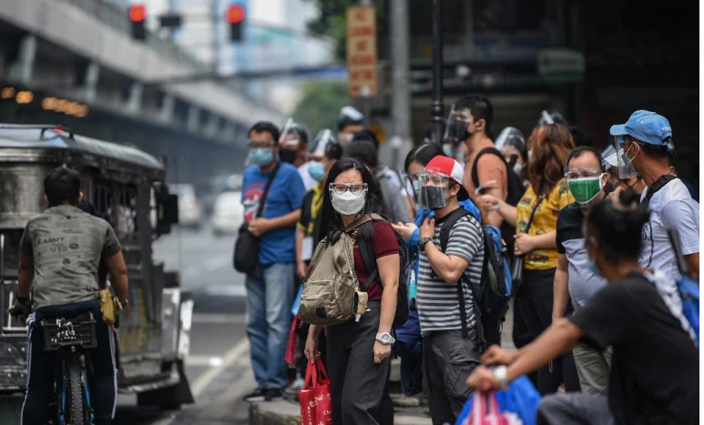 Philippines to relax COVID curbs even as cases hit record levels