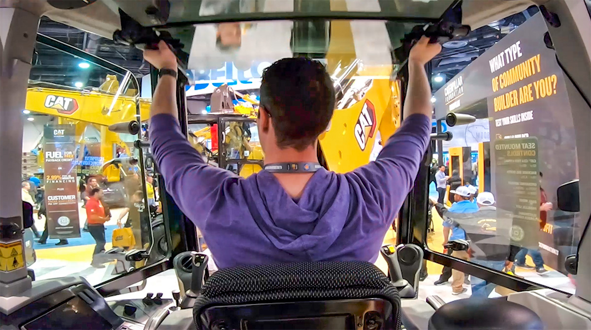 """Trade Show Recap Videographer captures attendees' engagement with the booth experience. Caterpillar Foundation hosted the """"Community Builder"""" experience at CONEXPO in Las Vegas."""
