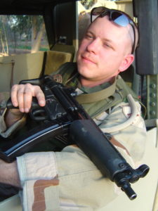Doc with MP5 in convoy humvee