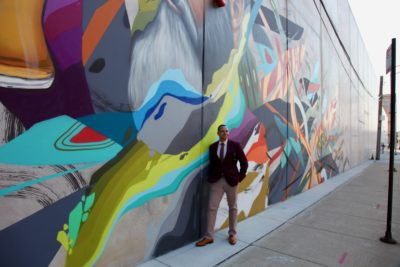 Practicing my modeling skills in front of the CH Distillery mural in Pilsen.