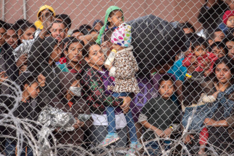 Migrants Waiting Outside Fence At Border