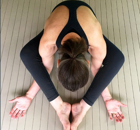 instructor in a yin butterfly pose
