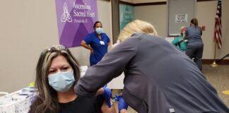 nurse receiving vaccine