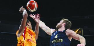 basketball players playing basketball