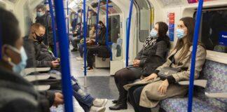 People on public transportation wearing masks