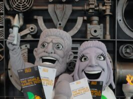 mascots resembling statues holding World Games tickets
