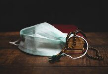quran, prayer beads and face mask