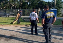 firefighters training with dummy