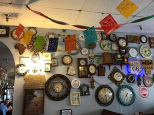 clock collection on wall and Mexican dorations
