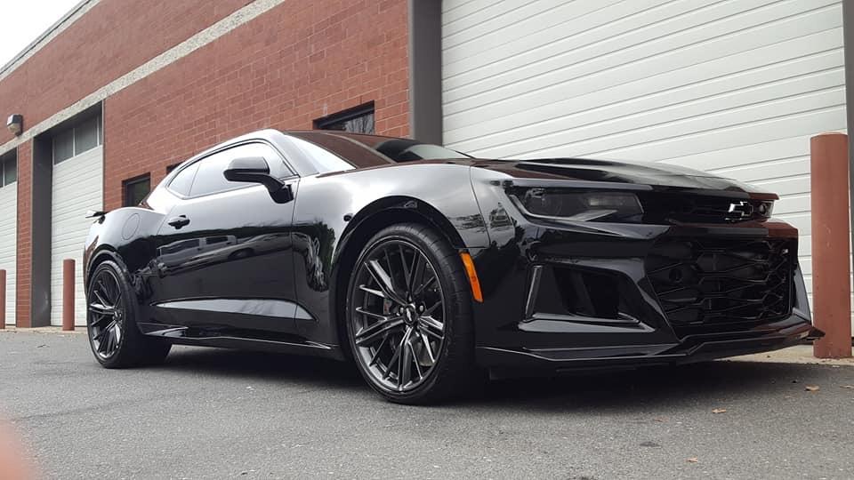 An all-black Chevrolet car