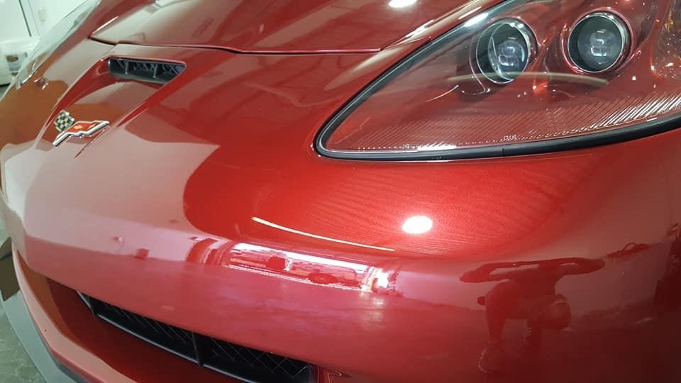 Shiny red Chevrolet Corvette car