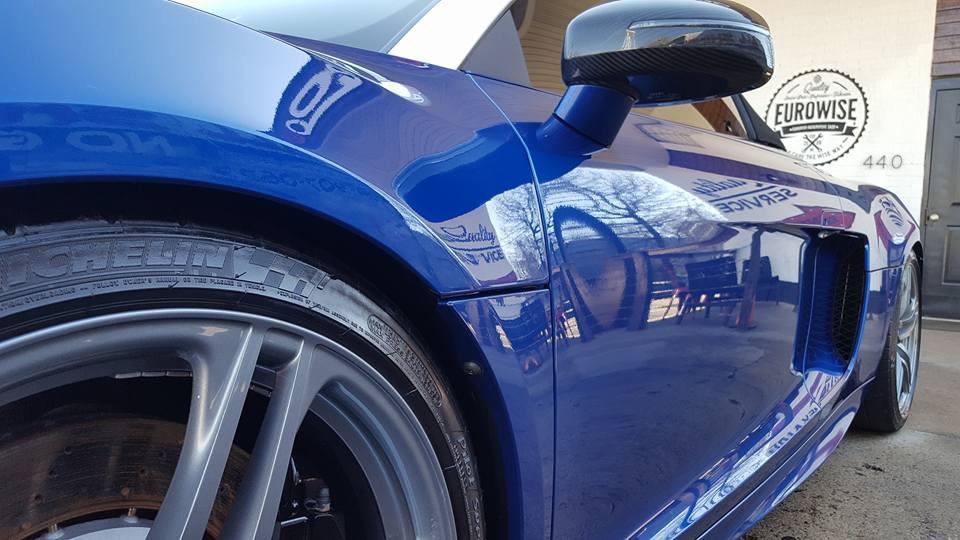 Side angle of a shiny blue car