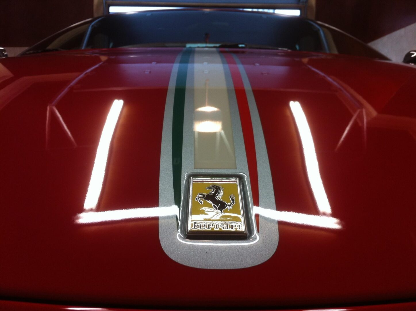 Front hood of a shiny red Ferrari car