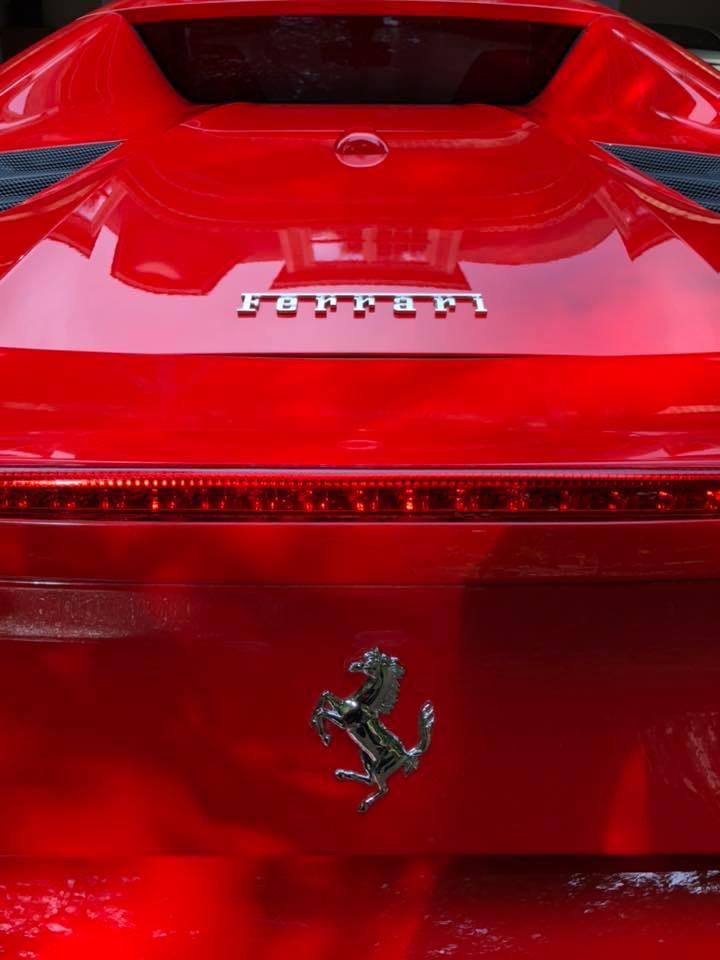 Trunk area of a red Ferrari car