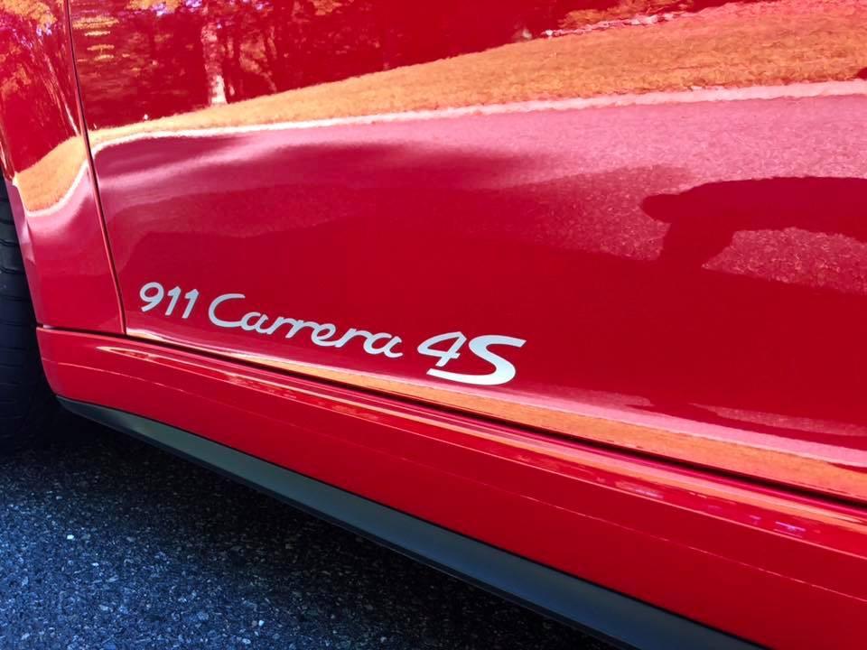 Shiny red Porsche 911 Carrera 4S
