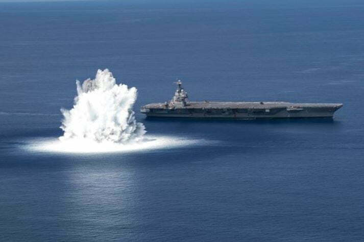 Bomb Exploding In Sea Next to Naval Ship