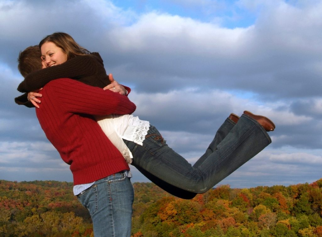 Happy-Couple-Embracing-on-a-Hilltop-in-Autumn-000002367960_Medium