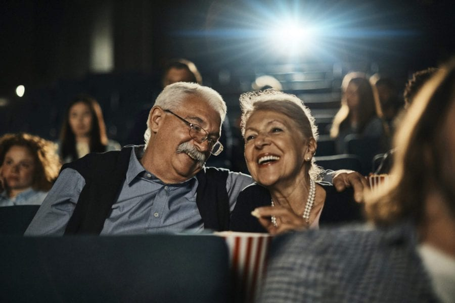 Close up of a senior couple enjoying a movie in the cinema