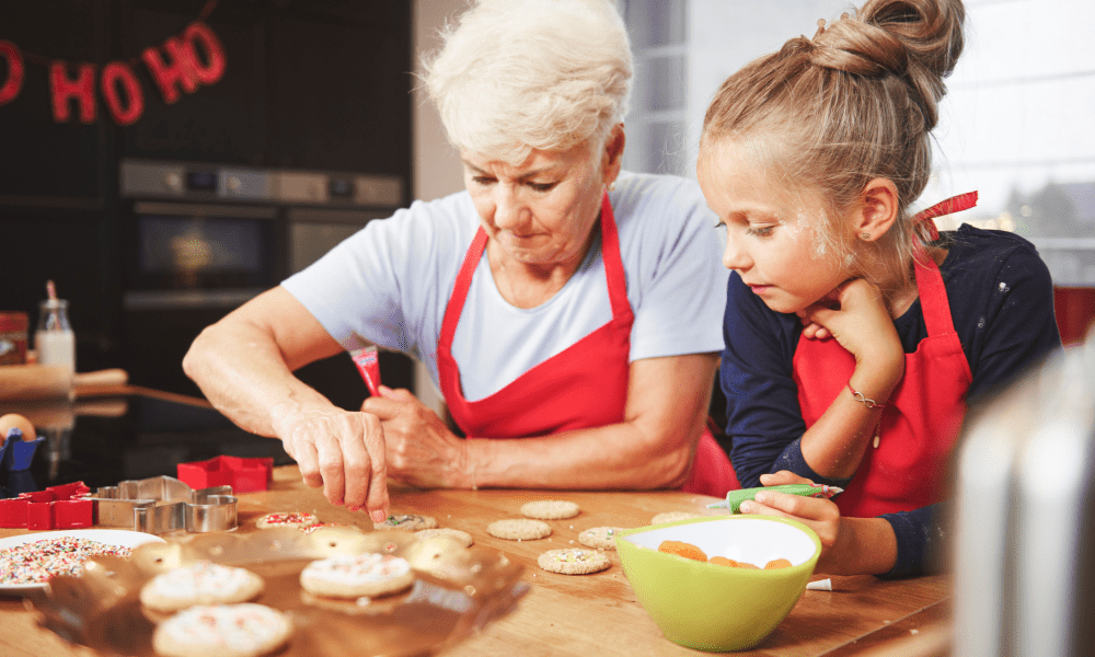 grandmother making Christmas cookies with grandchild
