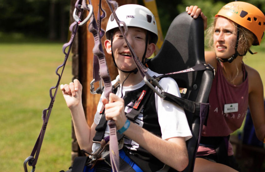 Young adult male enjoying the high ropes.