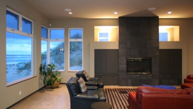 Living room build featuring a custom gas fireplace with porcelain tile surround