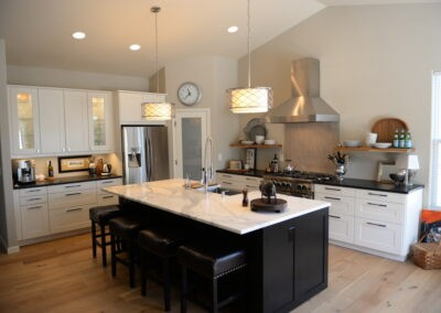 Kitchen island in black with white countertop