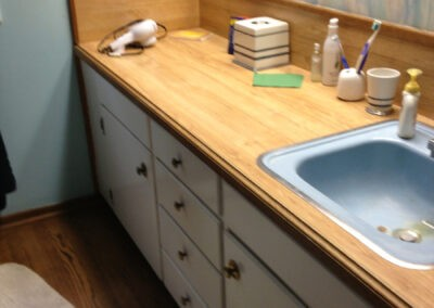 Photo of the vanity before the bathroom remodel