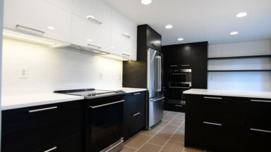 Kitchen remodel in Portland, OR featuring black and white IKEA kitchen cabinets