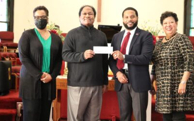 Wesley Presents $3,000 Scholarship to Huston-Tillotson University