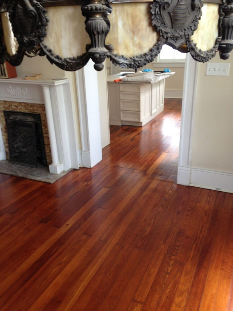 Refinished hardwood flooring in living room and kitchen